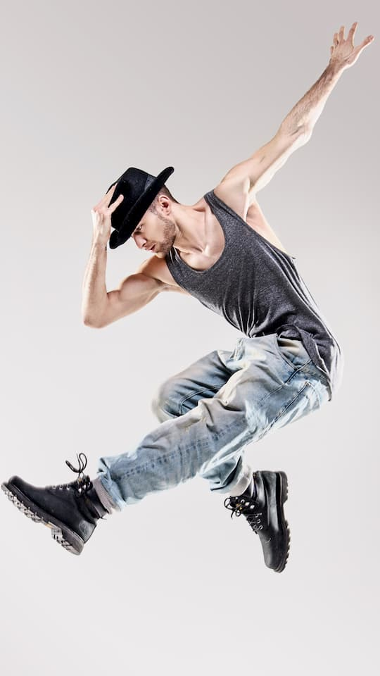 Male Dancer with Hat performing